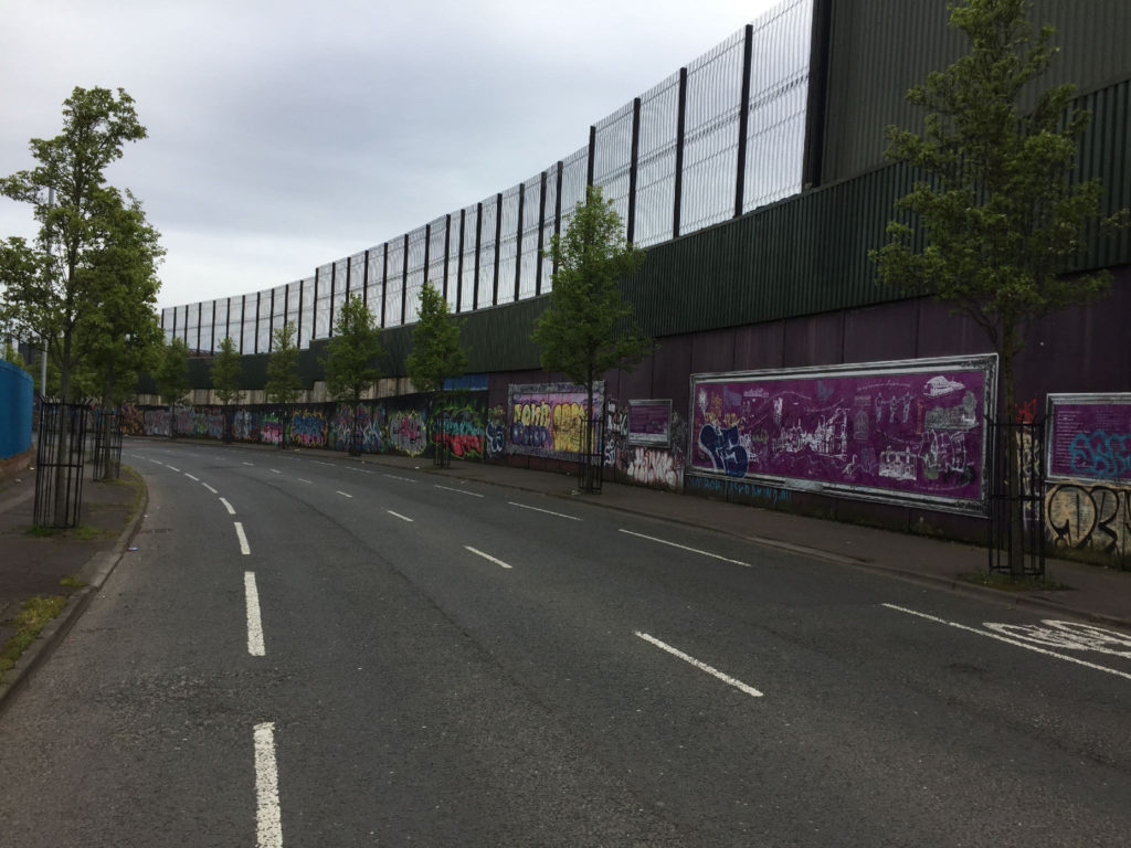 The tallest portion of the Belfast Wall separating Catholic and Protestant public housing neighbourhoods.